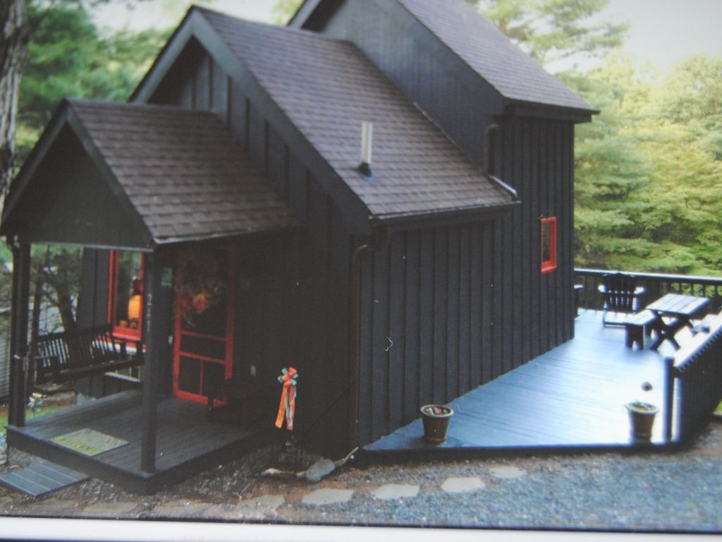 Front View Of Tiny Cabin With Lockbox Located By Front Door For Easy Access.
