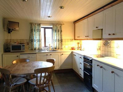 Large open Kitchen , with traditional Lakeland slate floor tiles