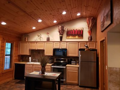 Welcoming, fully equipped kitchen. Tall wooden cielings & gorgeous decor!