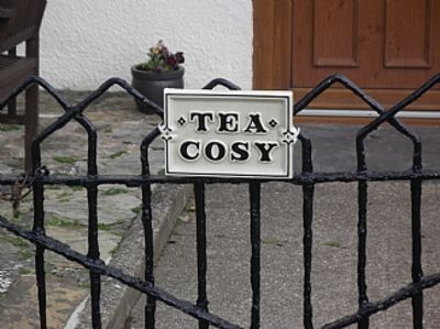 Photo for tea cosy cottage mid terrace cob house pub 500 meters beach 3 miles.