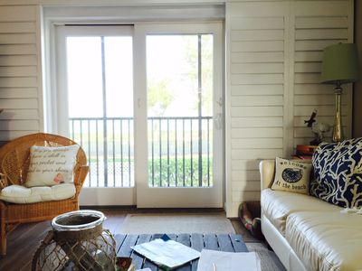 Living room- looking out to the beach through the screened porch balcony