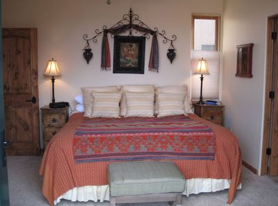 Master King bed, beautiful furnishings, French Doors to Balcony with  Mt.Views