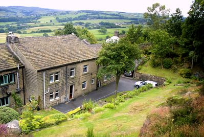 Set in two acres of woodland wildlife garden, with extensive Pennine views