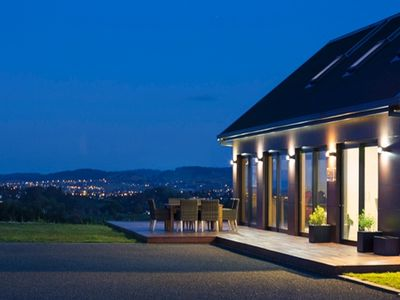 Photo for Stunning hill-top Eco Home with huge outdoor areas, fire, spa pool & views