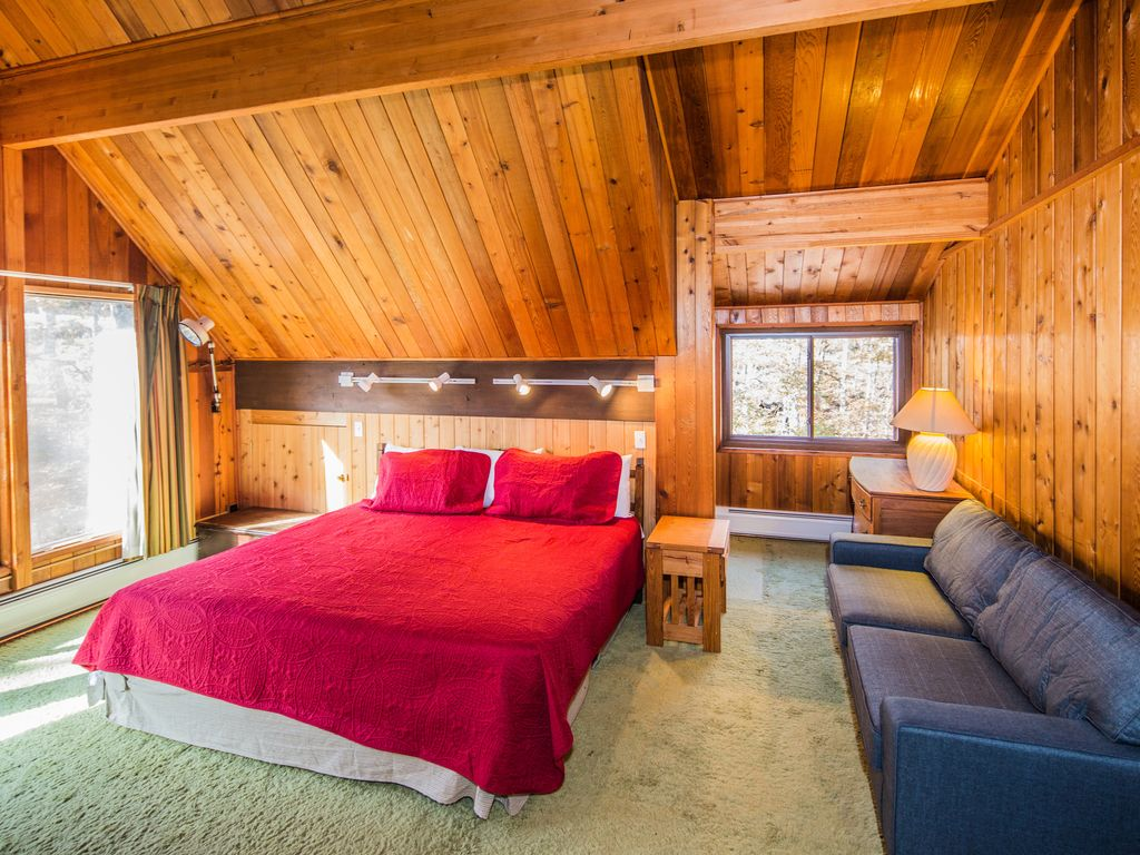Mountainside Lodge is a great home to spend your winter vacation with a fabulous great room and a field stone fireplace.