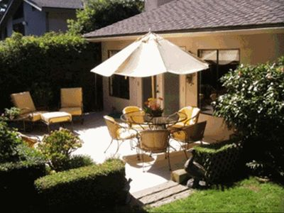 Tranquil, private patio with a small lawn and fragrant garden