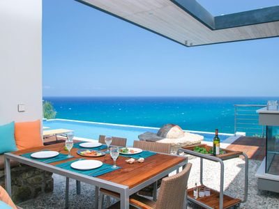 Photo for Villa Aqua is set in a fabulous and unique position with spectacular views over the sparking Mediter