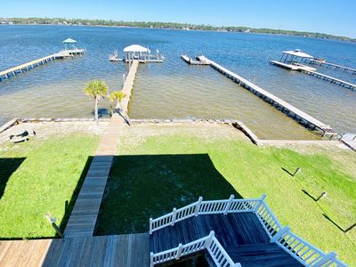Photo for Come enjoy this waterfront duplex with a boat dock. Close walk to beach & pet friendly!!!