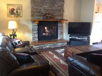 Living Room with gas fireplace and TV, DVD player, DVD movie collection and DVR.