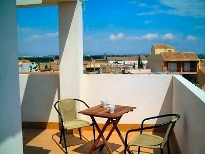 Photo for Town house with Private Sun Terrace and Large Shared Pool