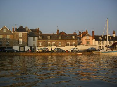 Front of Hannaford's Quay cottage from the estuary at high tide