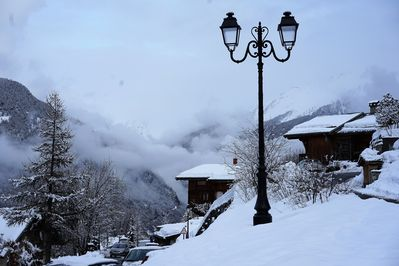 Chalet L'Orbeye in snow and clouds.