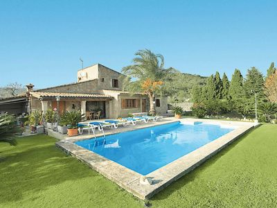 Photo for Farmhouse-turned-villa with amazing views, a pool and exotic gardens, close to town