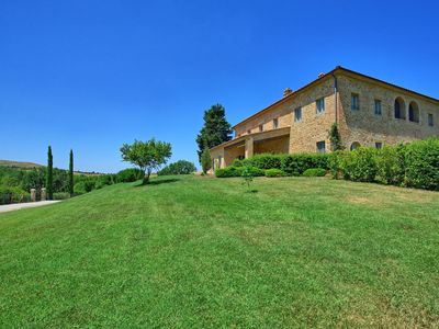Photo for Lovely apartment with WIFI, pool, A/C, TV, patio, panoramic view, parking, close to San Gimignano