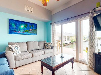 Photo for Lagoon-front, ground-level condo with shared pool - close to the beach