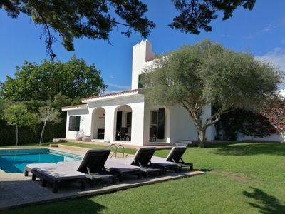 Photo for 4 bedrooms Villa with pool, Sea view - 3 min walk to Binibeca vell