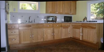 Kitchen with hickory accessible cabinets and propane stovetop