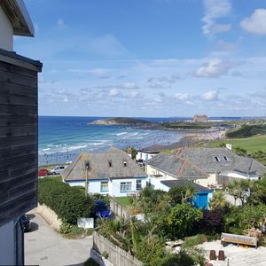 Photo for Amazing views of Fistral Beach with secure parking for 2 vehicles
