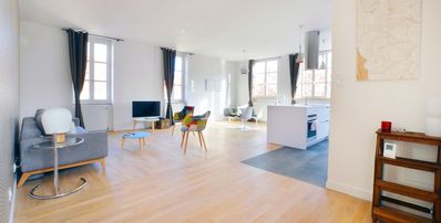 Photo for 88 sq.m loft with beautiful view over the city