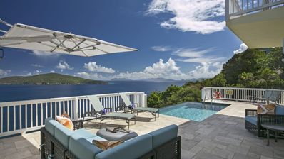 Expansive pool deck with down-island views