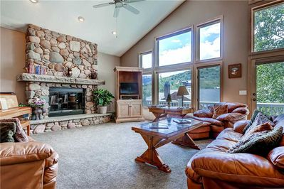 Vaulted ceilings ski slope views cozy gas fireplace large screen TV living room - Park City Lodging-3165 Thistle