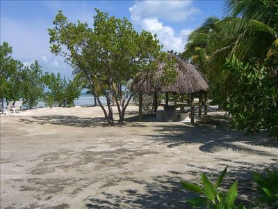Private beach complete with tiki huts and barbeque grills!