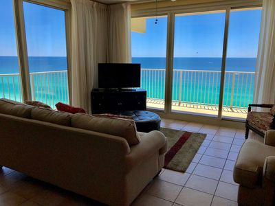 Photo for *Beach chairs included* oceanfront corner unit. Reserved parking