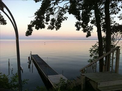 Dusk view of the dock and lake.