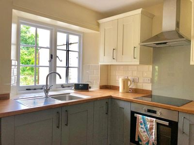 South facing kitchen overlooking the cottage garden