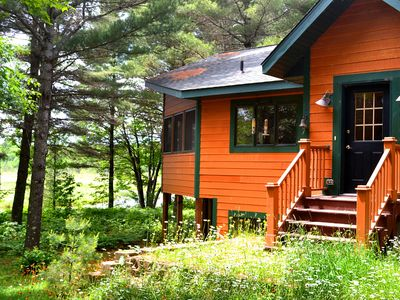 Photo for Lovely Pet Friendly Home on Trout River w/ Wood Burning Fireplace, A/C & More!