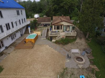 Cottage rental with private firepit and shared volleyball, swim pool spa, kayaks