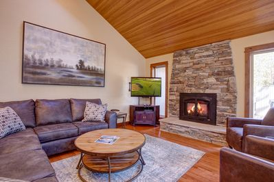"Living Room - Gather around the gas fireplace and the 42"" flat-screen TV in the living room."