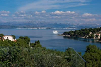 Ferry from Split is aproaching the Island - the view from the upper terrace.
