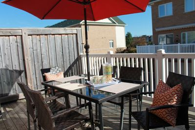Have a glass on the sunshine drenched private  deck with bbq