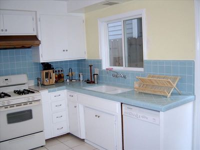 Large Kitchen features: Fridge, Dishwasher, oven, toaster, coffee, all utensals