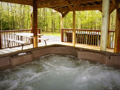 Photo for Comfortable six bedroom home with a Hot Tub, a Game room, two decks and a wood burning Fireplace.