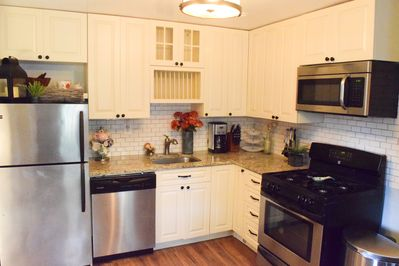 Granite countertops, soft close cabinets, stainless steel appliances