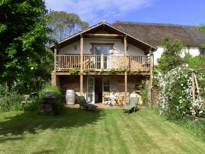 Photo for Converted Barn On Thatched Devon Longhouse Grounds At The Foot Of Rolling Hills.