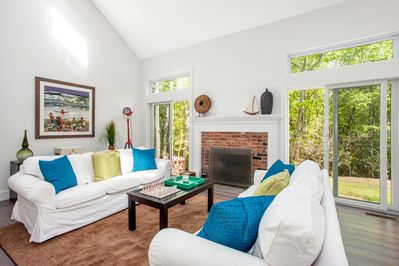 Light, airy living room with fireplace