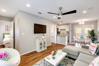 Unit B - The bright and cheery living room is open to the dining room and kitchen