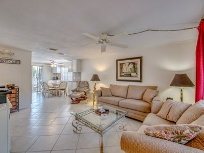 Photo for Beautiful beach home w/heated pool on canal/steps 2 Gulf or  pristine Estero Bay