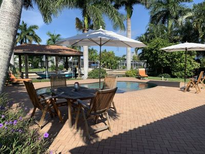 Photo for 2 houses from the beach, manatees living under your dock,  heated pool
