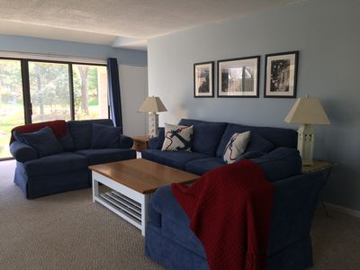 Large Great Room with Adjacent Dining Area and Sliders out to Patio and Lawn