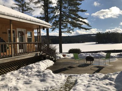 Winter view of the house and lake, with fire pit 🔥.