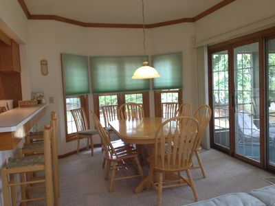 Expandable Dining room table with plenty of seating of seating.