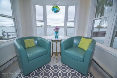 These barrel chairs swivel, so you can face the interior, or view the Bay!