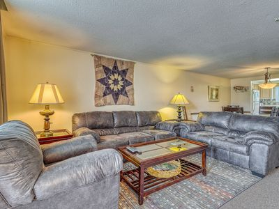 Photo for Expansive mountain condo w/private back deck, views of pond & snow tubing