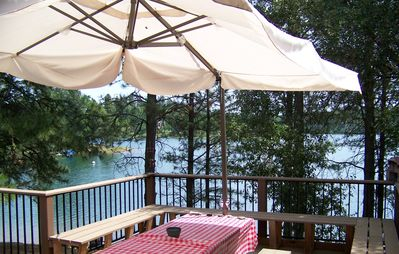 Perfect place to picnic with deckfront table and two other picnic tables nearby