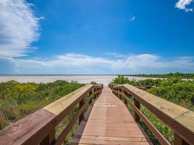 Photo for Trendy Beachfront Condo with relaxing Gulf views from the balcony - Walk to area attractrions