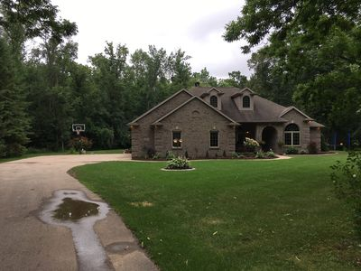 Photo for Beautiful Home with Wooded Lot - 4 Bedrooms - 14 Mins from EAA